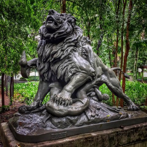 lion and snake sculpture
