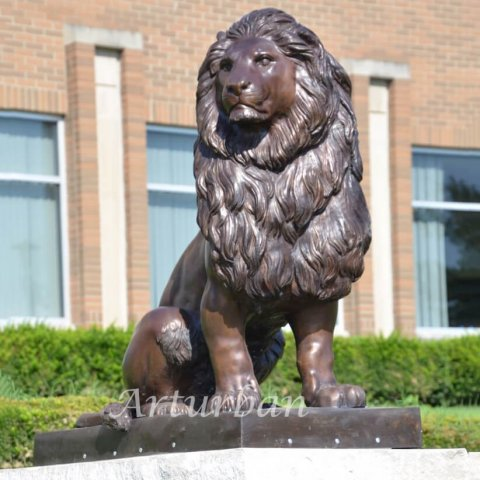 lion statues in front of house