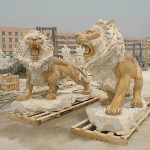 lion statue in front of homes