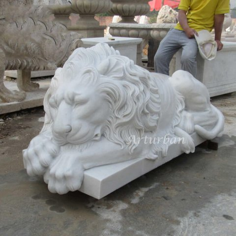 sleeping lion statue