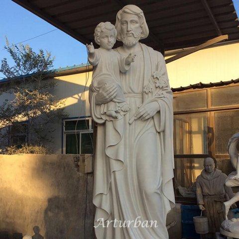 joseph holding baby jesus statue