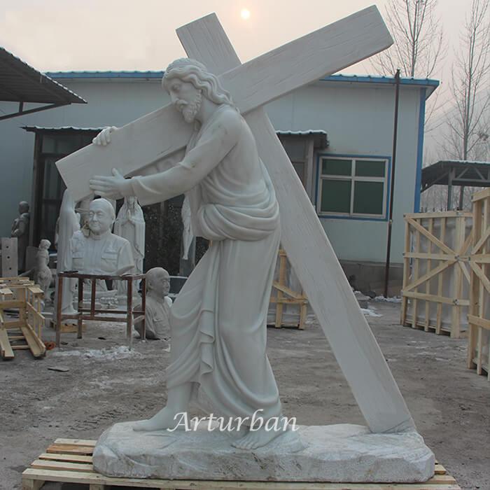 jesus carrying cross statue