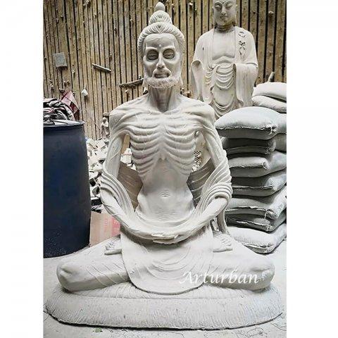 emaciated buddha statue