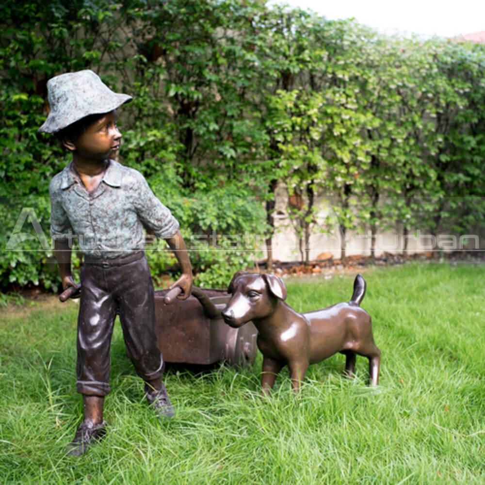 boy and dog garden statue