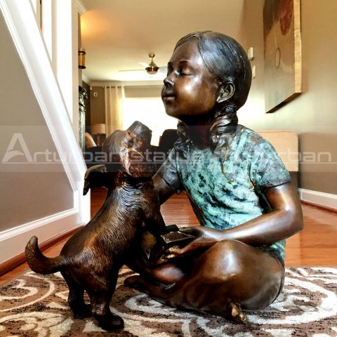 little girl with dog statue
