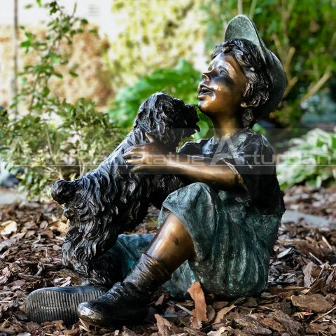 boy and dog garden statue