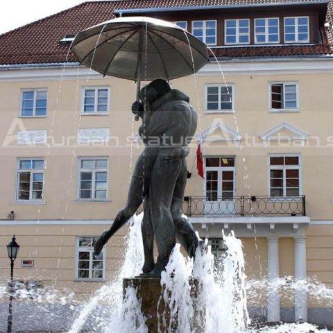 boy and girl umbrella bronze fountain