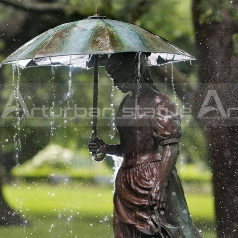 girl with umbrella bronze fountain