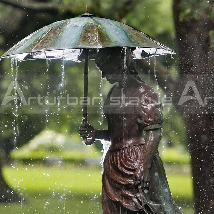 girl with umbrella bronze fountain