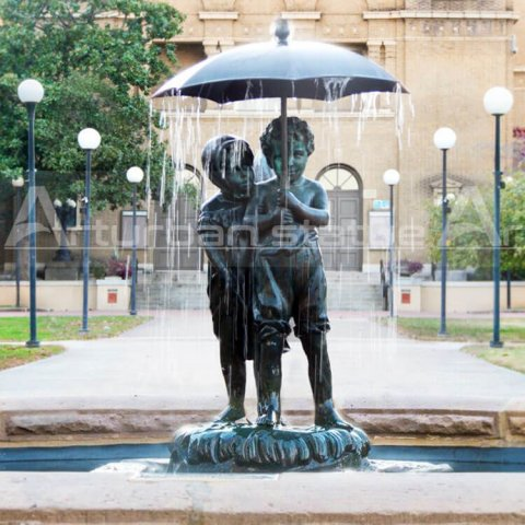 Girl And Boy With Umbrella Fountain