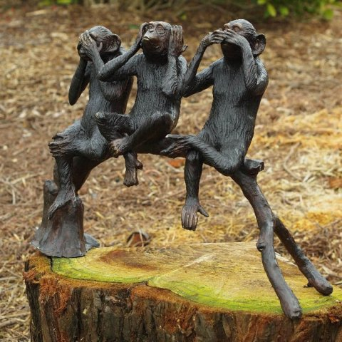 three monkeys statue