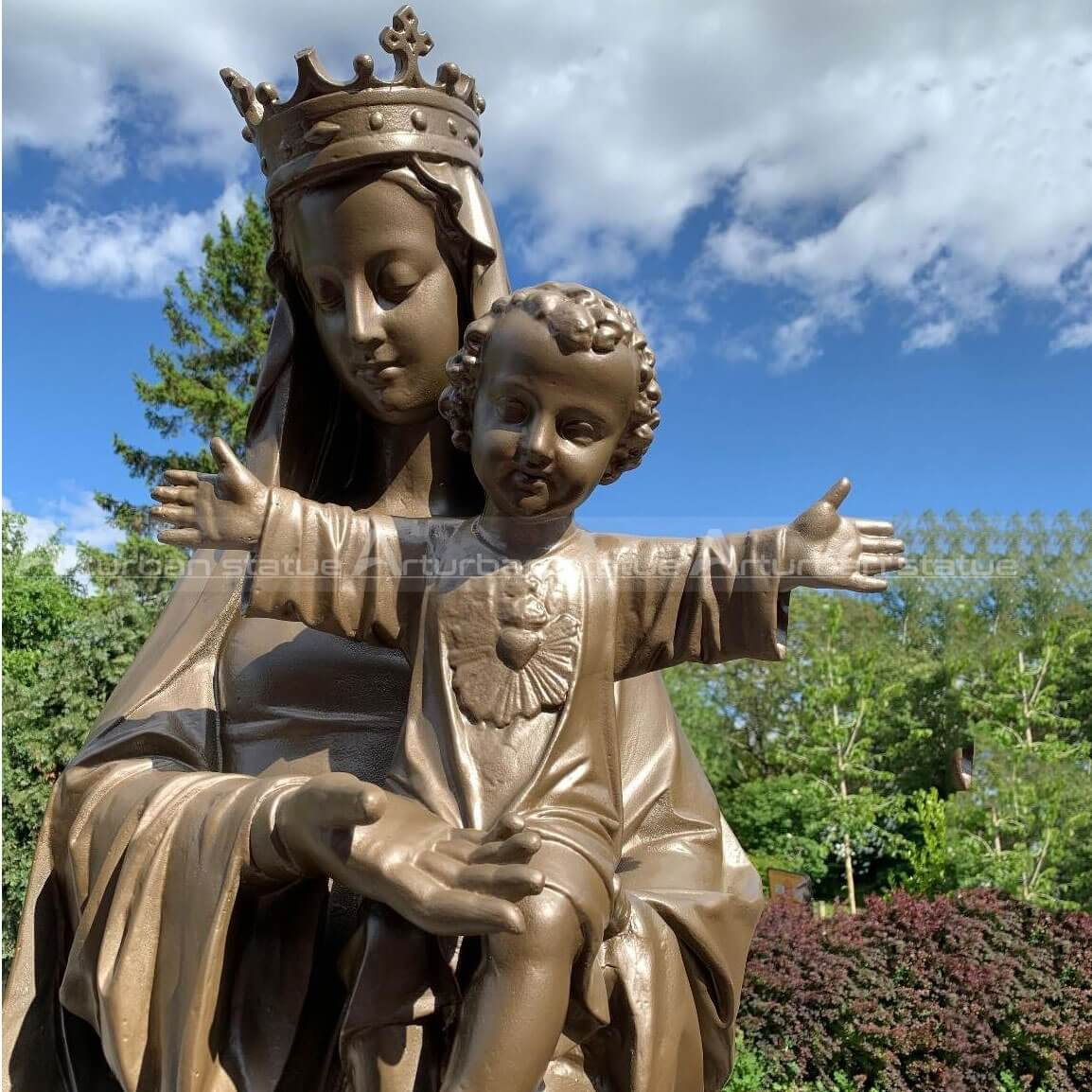 Sculpture of mary holding jesus