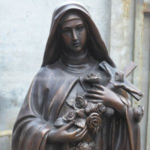 statue of our lady holding crucified christ