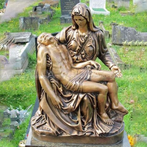 mary carrying jesus statue