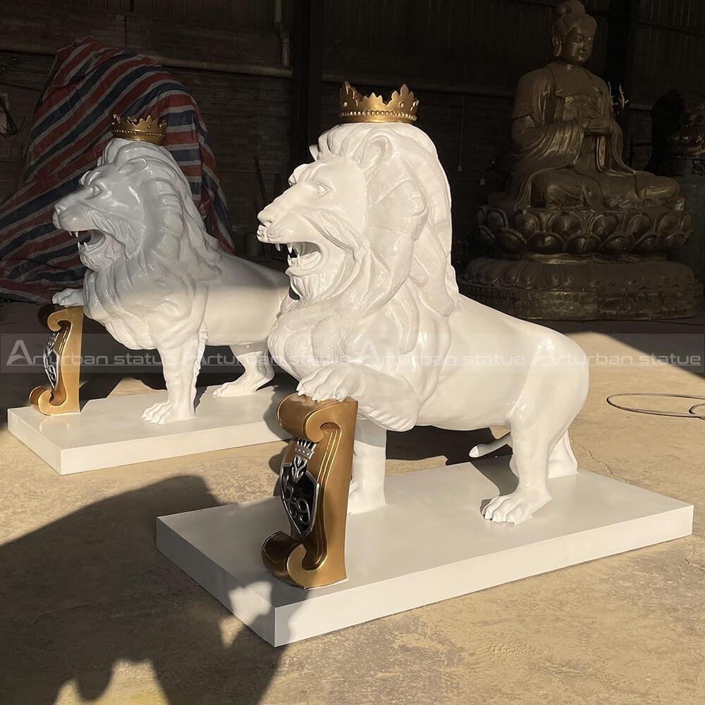 white lion statue with crown